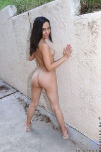 Tia Cyrus faces the wall naked